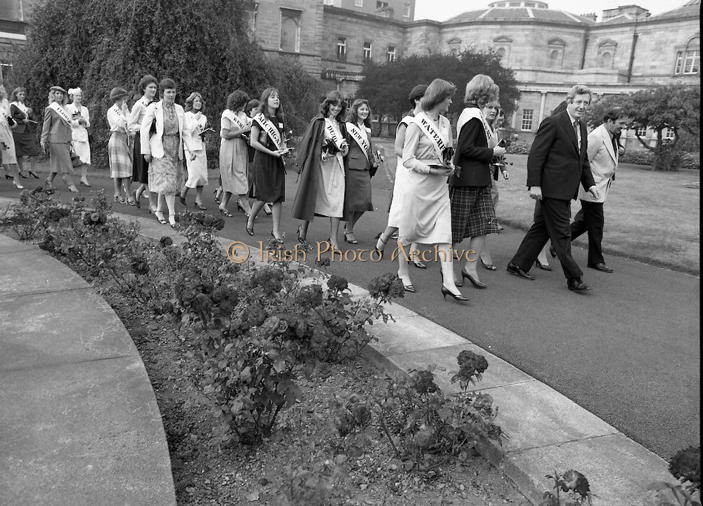 """An Taoiseach Meets The Roses Of Tralee.  (N90)..1981..28.08.1981..08.28.1981..28th August 1981..An Taoiseach, Garret Fitzgerald, met with the contestants of The Rose Of Tralee Festival when they were invited to Government Buildings, Leinster House, Dublin...Image shows a parade of """"Roses"""" led by An Taoiseach as they make their way to the reception inside Leinster House."""