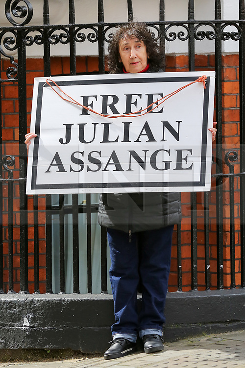 """© Licensed to London News Pictures. 05/04/2019. London, UK. A supporter of Julian Assange holds """"Free Julian Assange"""" placard outside Ecuadorian Embassy in Knightsbridge. Media reports state that the Ecuadorian Embassy plan to remove Julian Assange, Wikileaks founder from the embassy within days. Julian Assange claimed political asylum in the Ecuadorean Embassy in June 2012 after he was accused of rape and sexual assault against women in Sweden. Photo credit: Dinendra Haria/LNP"""