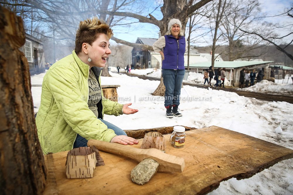 """(3/8/14, NATICK, MA) Instructors Deena Kanopkin, left, and Dede Dussault describe how Native Americans made maple syrup during Maple Magic Day at Natick Community Organic Farm on Saturday. The event featured a pancake breakfast and """"Maple Sugaring Past and Present,"""" where sugaring techniques were demonstrated. Daily News and Wicked Local Photo/Dan Holmes"""