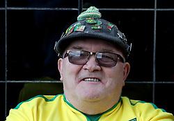 Norwich City fan Peter Wharton outside Carrow Road Norwich before kick off