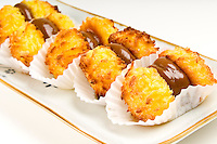 Caramel and coconut dessert bites, served in a tray.