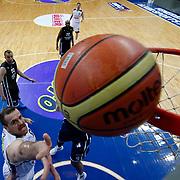 Fenerbahce Ulker's Oguz Savas (L) during their Turkish Basketball league derby match Fenerbahce Ulker between Anadolu Efes at the Ulker Sports Arena in Istanbul, Turkey, Monday, April 29, 2013. Photo by Aykut AKICI/TURKPIX