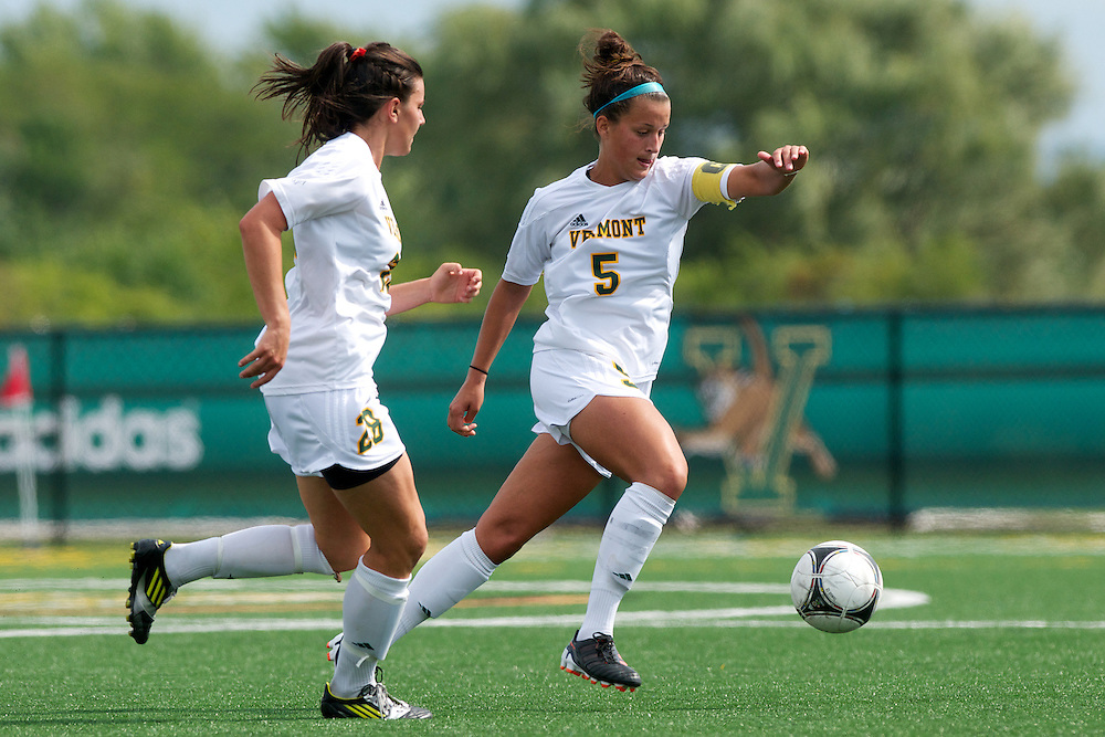 Vermont midfielder Alexa DeMaio (5) controls the ball as Vermont defenseman Jill Dellipriscoli (28) looks on during the women's soccer game between the Brown Bears and the Vermont Catamounts at Virtue Field on Saturday afternoon September 8, 2012 in Burlington, Vermont.