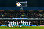 Queens Park Rangers players during a minute's silence in honour of Gordon Banks during The FA Cup 5th round match between Queens Park Rangers and Watford at the Loftus Road Stadium, London, England on 15 February 2019.