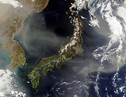 Satellite view of Japan with snow-covered mountains, Spring greening land at lower levels. Dust from mainland China blowing over the Sea of Japan, and out into the Pacific Ocean.  Credit: NASA. Science Earth Erosion Geology