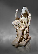 Roman statue of a seated woman . Marble. Perge. 2nd century AD. Inv no 17.7. . Antalya Archaeology Museum; Turkey.  Against a grey background .<br /> <br /> If you prefer to buy from our ALAMY STOCK LIBRARY page at https://www.alamy.com/portfolio/paul-williams-funkystock/greco-roman-sculptures.html . Type -    Antalya     - into LOWER SEARCH WITHIN GALLERY box - Refine search by adding a subject, place, background colour, museum etc.<br /> <br /> Visit our ROMAN WORLD PHOTO COLLECTIONS for more photos to download or buy as wall art prints https://funkystock.photoshelter.com/gallery-collection/The-Romans-Art-Artefacts-Antiquities-Historic-Sites-Pictures-Images/C0000r2uLJJo9_s0