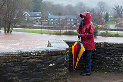 © Licensed to London News Pictures. 20/01/2021. Crickhowell, Powys, Wales, UK.  After recent heavy rainfall from Storm Christoph the river Usk has burst it's banks at Crickhowell, Powys, Wales, UK. Photo credit: Graham M. Lawrence/LNP