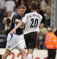 Photo: Daniel Hambury.<br /> Fulham v Everton. The Barclays Premiership.<br /> 27/08/2005.<br /> Fulham's goal scorer Brian McBride is congratulated by Everton boss, David Moyes.