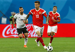 June 19, 2018 - Saint Petersburg, Russia - Fedor Smolov (C)  of the Russia national football team vie for the ball during the 2018 FIFA World Cup match, first stage - Group A between Russia and Egypt at Saint Petersburg Stadium on June 19, 2018 in St. Petersburg, Russia. (Credit Image: © Igor Russak/NurPhoto via ZUMA Press)