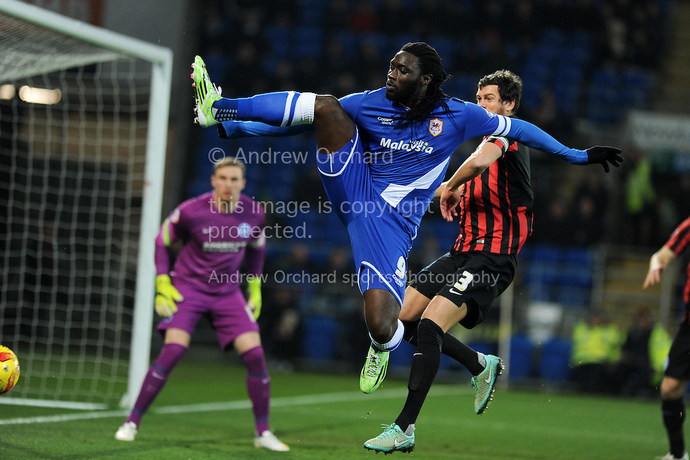 Kenwyne Jones of Cardiff city in action. Skybet football league championship match, Cardiff city v Brighton & Hove Albion at the Cardiff city Stadium in Cardiff, South Wales on Tuesday 10th Feb 2015.<br /> pic by Andrew Orchard, Andrew Orchard sports photography.