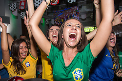 July 2, 2018 - FL, USA - Brazil supporter Bruna Bastos, center, celebrates Brazil's victory over Mexico at a FIFA World Cup Round of 16 knockout stage watch party at Vares in Brickell on Monday, July 2, 2018. (Credit Image: © Sam Navarro/TNS via ZUMA Wire)