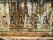 "14 MARCH 2105 - SIEM REAP, SIEM REAP, CAMBODIA: Stone figures cut into a wall in Preah Khan, a temple in the Angkor Wat complex. The area known as ""Angkor Wat"" is a sprawling collection of archeological ruins and temples. The area was developed by ancient Khmer (Cambodian) Kings starting as early as 1150 CE and renovated and expanded around 1180CE by Jayavarman VII. Angkor Wat is now considered the seventh wonder of the world and is Cambodia's most important tourist attraction.    PHOTO BY JACK KURTZ"
