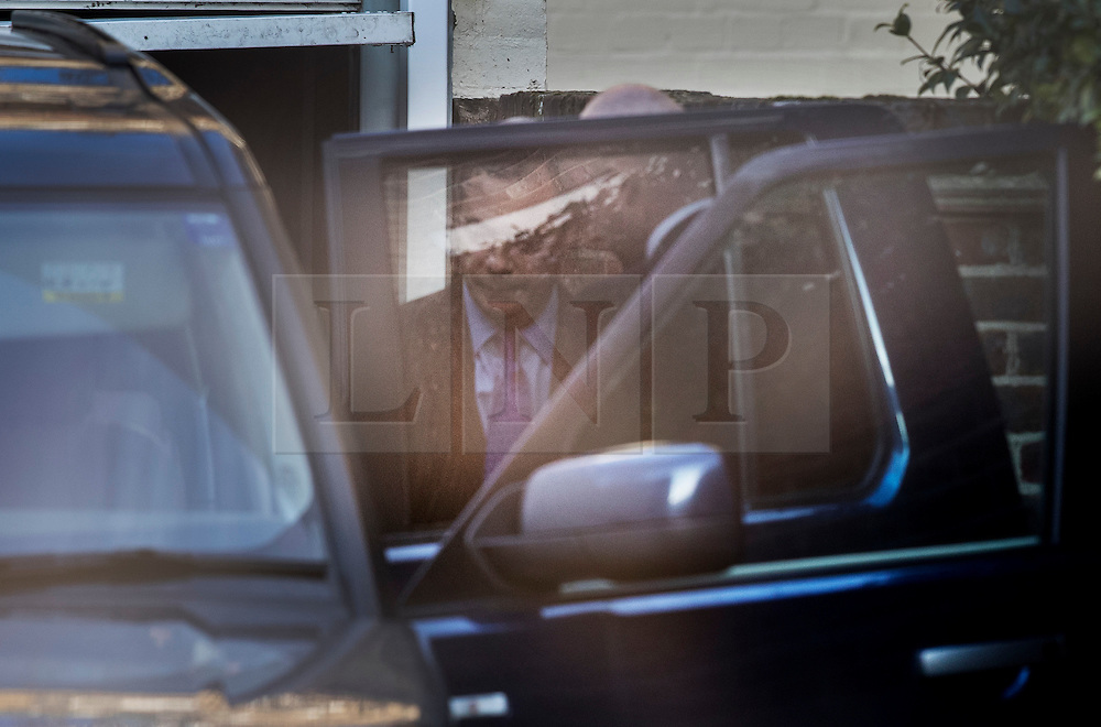 © Licensed to London News Pictures. 06/02/2017. London, UK. Nigel Farage is glimpsed behind his car door as he leaves his London house after it was revealed that French politician Laure Ferrari has also been staying at the £4 million property. Photo credit: Peter Macdiarmid/LNP