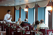 Passengers are seen at the Puerto Olimpico restaurant on the Grimaldi Lines Cruise Barcelona during the Barcelona-Civitavecchia trip, in Italy, on Tue., June 11, 2013.  Photographer: Víctor Sokolowicz/Bloomberg.