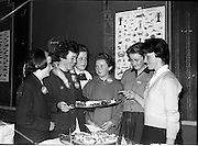 03-04/03/1964<br /> 03/03-04/1964<br /> 03-04 March 1964<br /> B.I.M. Fish Cookery Competition, Munster final, winners at the Metropole Hotel, Cork. The competition was held at the School of Commerce Cork. Photo Shows: Munster finalist Miss Phyllis Cliffe (2nd from left) showing her prizewinning dish to (l-r): Philomena Kelleher, 2nd prize (Thurles); Bernadette O'Connell, (Ennistymon); Marie Galvin, 3rd prize (Killorglin); Bridget Ryan (Cappamore) and Sheila Hurley (Bantry).