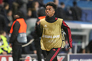 Manchester United Midfielder Angel Gomes warms up as a substitute during the Champions League Round of 16 2nd leg match between Paris Saint-Germain and Manchester United at Parc des Princes, Paris, France on 6 March 2019.