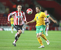 Jamie Cureton (Norwich City) and Chris Perry (Southampton)<br /> Southampton vs Norwich City Coca-Cola Championship St Mary's Stadium 30/9/2008<br /> Credit Colorsport / Shaun Boggust
