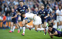 France's Romain Ntamack scores his side's first try of the game during the Guinness Six Nations match at the Stade De France, Paris.