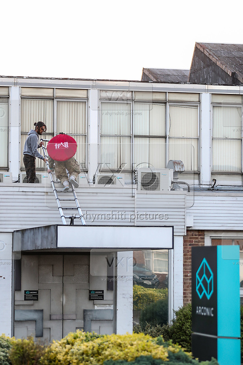 Birmingham, United Kingdom, June 14, 2021: Two activist appears to be climbing to occupy an American industrial company admin office specializing in lightweight metals engineering and manufacturing known as Arconic in Bermingham on Monday, June 14, 2021.  (Photo by Vudi Xhymshiti)