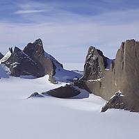 "ANTARCTICA, Queen Maud Land.  Fenris Mountains. Right to Left: Holtanna (2650m) (west face), Holsttind (2577m), Kinntanna (2721m) & Ulvetanna (2931m). Fenristunga Glacier (""Tongue of the Fenris Wolf"") foreground."