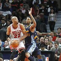 26 March 2012: Denver Nuggets small forward Wilson Chandler (21) defends on Chicago Bulls forward Taj Gibson (22) during the Denver Nuggets 108-91 victory over the Chicago Bulls at the United Center, Chicago, Illinois, USA. NOTE TO USER: User expressly acknowledges and agrees that, by downloading and or using this photograph, User is consenting to the terms and conditions of the Getty Images License Agreement. Mandatory Credit: 2012 NBAE (Photo by Chris Elise/NBAE via Getty Images)