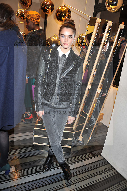 SAI BENNETT at a party to celebrate the launch of a limited edition shoe The Chambord in celebration of Nicholas Kirkwood's partnership with Chambord black raspberry liqueur, held at the Nicholas Kirkwood Boutique, 5 Mount Street, London on 12th December 2012.
