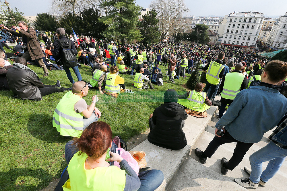 March 23, 2019 - Paris, Ile-de-France, France - Yellow Vest protesters gather in front of the Sacre Coeur Basilica in Montmartre, in Paris on March 23, 2019, during an anti-government demonstration called by the 'Yellow Vest' (gilets jaunes) movement. Demonstrators hit French city streets again on March 23, for a 19th consecutive week of nationwide protest against the French President's policies and his top-down style of governing, high cost of living, government tax reforms and for more ''social and economic justice. (Credit Image: © Michel Stoupak/NurPhoto via ZUMA Press)