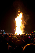 Huge bonfire on bonfire night in Battersea Park, London. This big fire is set for the gathered crowd to celebrate Guy Fawkes Night which is always celebrated on 5th November.