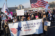 January, 21st, 2017 - Paris, Ile-de-France, France: Women Democrats Abroad with banner with Trocadero behind. Thousands of protesters in Paris join anti-Trump Women's March around the world.