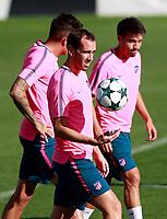Atletico de Madrid's Diego Godin (l) and Nico Gaitan during training session. September 26,2017.(ALTERPHOTOS/Acero)