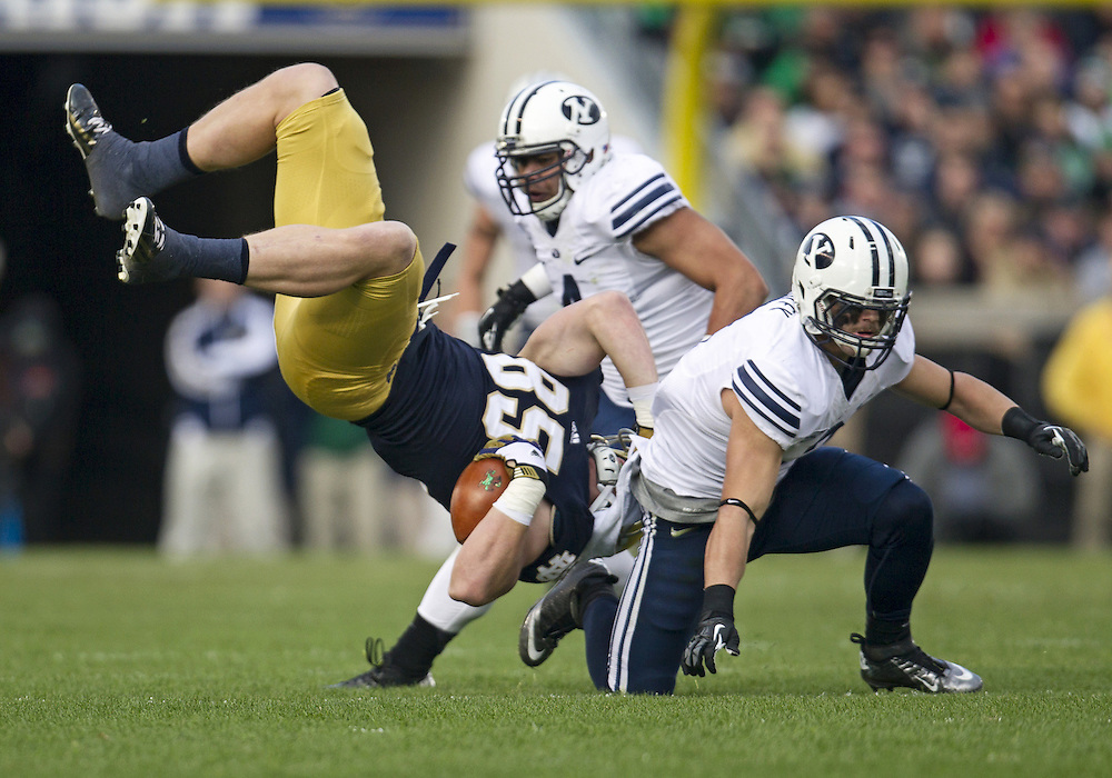 October 20, 2012:  Notre Dame tight end Troy Niklas (85) is upended by BYU linebacker Spencer Hadley (2) during NCAA Football game action between the Notre Dame Fighting Irish and the BYU Cougars at Notre Dame Stadium in South Bend, Indiana.  Notre Dame defeated BYU 17-14.