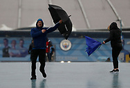Fans struggle with his umbrellas after the Premier League match between Manchester City and West Ham United was postponed because of weather conditions at the Etihad Stadium, Manchester. Picture date: 9th February 2020. Picture credit should read: Darren Staples/Sportimage