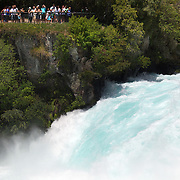 The Huka Falls are the largest falls on the Waikato River, near Taupo on New Zealand's North Island..They are the most visited natural attraction in New Zealand!.The Waikato river is one of New Zealand's longest rivers and it drains Lake Taupo - the largest freshwater lake in all of Australasia. .At the Huka Falls, the Waikato River which is normally 100m wide, is squeezed through a 20 metre wide gorge and over a 20m drop..Every second up to 220,000 litres of water gushes through the gorge and shoots out over 8 metres beyond to create a beautful blue/green pool...The name Huka is the Maori word for 'foam', which is appropriate as the falling water and rapids certainly resembles foam, especially under flooding conditions.Lake Taupo, New Zealand,, 8th January 2011.  Photo Tim Clayton.