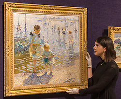 Bonhams, London, February 22nd 2017. Bonhams in London hold a press preview ahead of their 19th century paintings sale, featuring numerous valuable works including:<br /> • 'Children by the shore' by Dorothea Sharp, valued at £60,000-80,000<br /> • Barcas y pescaadores, Playa de Valencia by Joaquin Sorolla £60,000-80,000<br /> • When the Boats Come In by Walter Osborne valued at £100,000-150,000<br /> • A Solicitation by Lawrence Alma-Tadema which is expected to fetch between £30,000-50,000<br /> PICTURED: A Gallery technician adjusts Children by the shore' by Dorothea Sharp.