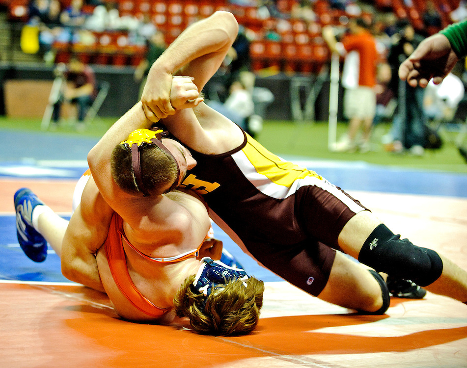 (staff photo by Matt Roth)..Hereford heavy weight Taylor Gload, who weighed in at 198, pinned Reservoir's Josh Hamilton in 3:11 to win the 3A/4A 285 weight State Wrestling Championship title. The contest was held at The University of Maryland's Cole Field House Saturday, March 6, 2010.