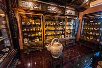 A display of ancient tea pots used for dispensing herbal remedies, Museum of Traditional Vietnamese Medicine, Ho Chi Minh City (Saigon), Vietnam.