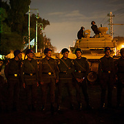 December 11, 2012 - Cairo, Egypt: Egyptian Army men take guard at the presidential palace in Cairo where tens of thousands gather outside to voice their anger at the planned constitution, which will be put to a referendum next Saturday...The Egyptian army has reportedly called talks between President Mohamed Morsi and the opposition to end violent protests against a draft constitution...Sporadic clashes between supporters and opponents of president Mohamed Morsi, erupted in the past week over his assumption of extraordinary powers and the scheduling of the referendum. (Paulo Nunes dos Santos/Polaris)