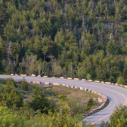 A bicyclist on the road up Cadillac Mountain in Maine's Acadia National Park.