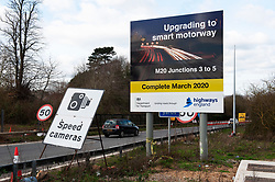 ©Licensed to London News Pictures 05/02/2020<br /> Maidstone, UK. M20 Smart motorway upgrade sign. The UK government has stopped all Smart motorway development schemes while it awaits the results of a review into their safety. This means a £92 million stretch of the M20 in Kent will not open as a smart motorway until the review has been completed. The new 6.5 mile section between junctions three and five near Maidstone was due to open next month but now may never open as a smart motorway. Photo credit: Grant Falvey/LNP