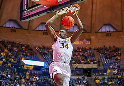 Dec 14, 2019; Morgantown, WV, USA; West Virginia Mountaineers forward Oscar Tshiebwe (34) dunks the ball during the second half against the Nicholls State Colonels at WVU Coliseum. Mandatory Credit: Ben Queen-USA TODAY Sports
