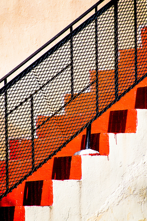 A Miami Modern stair railing on a small apartment house on Bay Harbor Islands