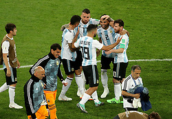 Argentina's Lionel Messi (right), Sergio Aguero (front), Marcos Rojo (left), Nicolas Otamendi (back) and Gabriel Mercado (2) celebrate after the final whistle during the FIFA World Cup Group D match at Saint Petersburg Stadium.