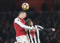 Football - 2017 / 2018 Premier League - Arsenal vs. Newcastle United<br /> <br /> Laurent Koscielny (Arsenal FC) rises above Dwight Gayle (Newcastle United) at The Emirates.<br /> <br /> COLORSPORT/DANIEL BEARHAM