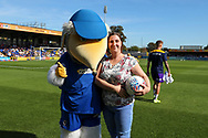 sponsor and Haydon the Womble during the EFL Sky Bet League 1 match between AFC Wimbledon and Shrewsbury Town at the Cherry Red Records Stadium, Kingston, England on 14 September 2019.