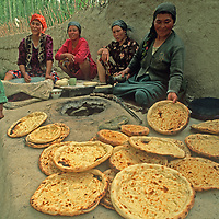 Uygur women bake flatbread in a tandoor oven in Mingyol village in the Kara Tagh Mountains near Kashgar (Kashi), a city on the ancient Silk Road in Xinjiang, China.