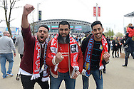 a Group of Liverpool and Aston Villa fans cheering outside Wembley Stadium before k/o. The FA Cup, semi final match, Aston Villa v Liverpool at Wembley Stadium in London on Sunday 19th April 2015.<br /> pic by John Patrick Fletcher, Andrew Orchard sports photography.