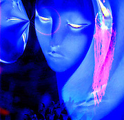 Two glowing faces about to make contact.Black light