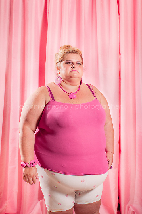 """FORCOLI, ITALY - 23 JULY, 2011: Patrizia, 46, participates at Miss Cicciona (Miss Chubby), a pageant open only to women who weigh more than 220 pounds, in Forcoli, Italy. Miss Cicciona gives plus-size women, who could normally not eventer beauty pageants, an opportunity to take home a tiara. """"The competition aims to recognize and give light to the beauty and simple and true affection of women who usually ... are excluded from the spotlight,"""" wrote pageant founder Gianfranco Lazzereschi on the Miss Cicciona website."""