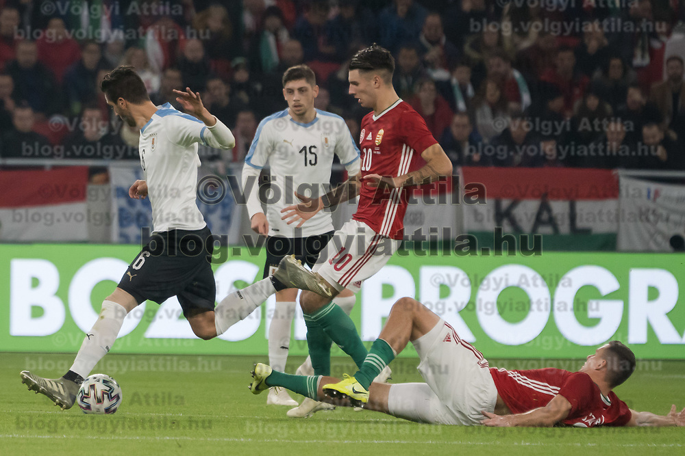 Rodrigo Bentancur (L) of Uruguay and Dominik Szoboszlai (2nd R) of Hungary fight for the ball during the inauguration match of the newly reconstructed Ferenc Puskas Stadium between Hungary and Uruguay in Budapest, Hungary on Nov. 15, 2019. ATTILA VOLGYI