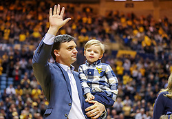Jan 12, 2019; Morgantown, WV, USA; West Virginia Mountaineers head football coach Neal Brown and is family are welcomed by fans during the first half of a game against the Oklahoma State Cowboys at WVU Coliseum. Mandatory Credit: Ben Queen-USA TODAY Sports